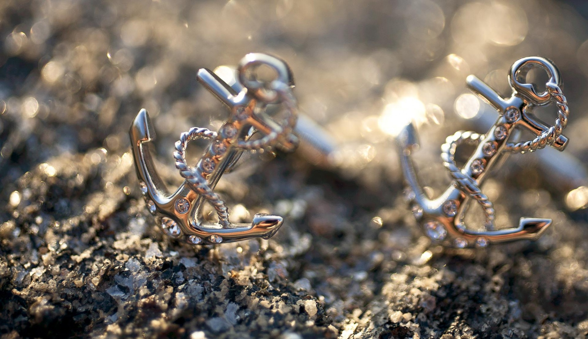 Anchor cufflinks on a stone surface